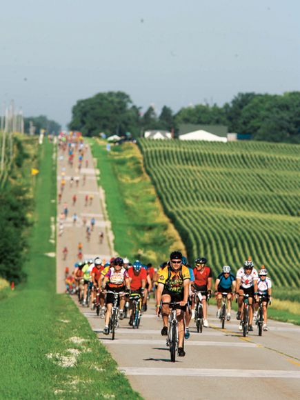 RAGBRAI riders make their way along Greene County E26 between Dana and Ogden.