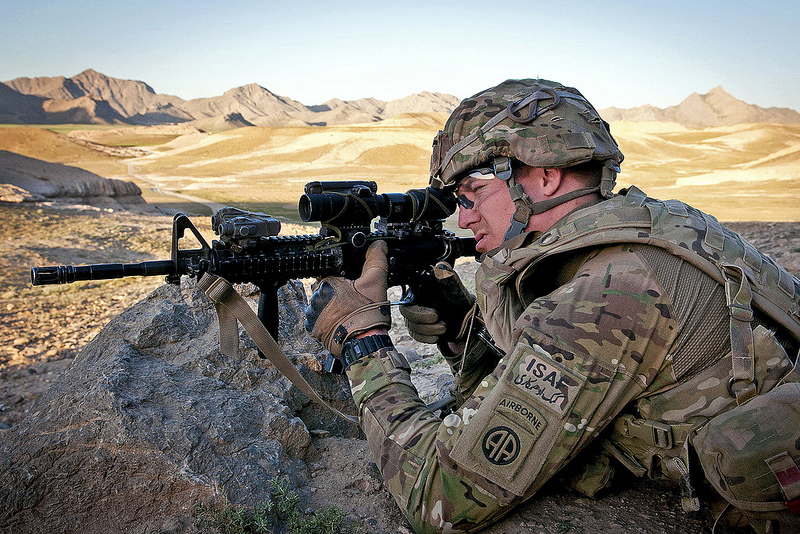 Guns and Military A paratrooper with the 82nd Airborne Division's 1st Brigade Combat Team pulls security during a combat operation June 2, 2012, in Ghazni Province, Afghanistan.