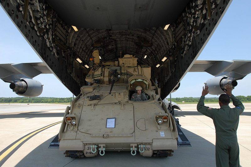 Guns and Military Pfc. Joseph Salerna, 2nd Battalion, 69th Armor Regiment, 3rd Heavy Brigade Combat Team, 3rd Infantry Division, backs his Bradley Fighting Vehicle aboard a C-17 Globemaster III aircraft