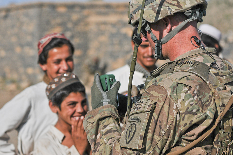 Guns and Military U.S. Army Staff Sgt. Chad Bordelon, 1st Battalion (Airborne), 501st Infantry Regiment, gives villagers a self-wind radio while conducting a security patrol in Shaway Valley, June 2, 2012.