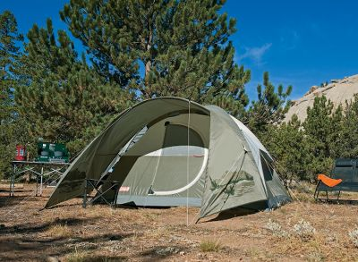 "Camp and Hike Enjoy all-weather comfort and Coleman reliability at an economical price. This Cabela's-exclusive tent sets up easily with color-coded sleeves, pin-and-ring pole anchors and Insta-Clip attachments. It has a durable 1,000-denier polyethylene floor, polyester rain fly and walls, Coleman's VariFlow vent system with privacy window, and a patent-pending hinged door. Fiberglass poles included. Imported.Sleeping capacity: 6.Center height: 72"".Floor size: 10 x 10 .Weight: 19 lbs. 13 oz. - $189.99"