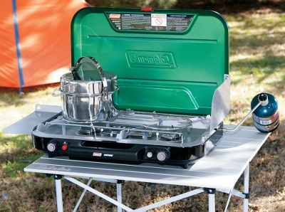 Camp and Hike EvenTemp in-line burner design provides even heat distribution for cooking without cold spots. Three stainless steel burners offer 28,000 BTU of cooking power. Removable nickel-chrome-plated grate. Extra-large chassis. InstaStart lighting. Operates on one 16.4 oz.-propane cylinder (sold separately). Folded dimensions: 4.3H x 24.2W x 17.3D. Weight: 19.4 lbs. Color: Stainless. - $99.99
