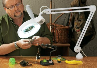 Flyfishing Make even the smallest of flies easy to see with this 5X magnifying lamp. Easily adjustable swing arm has tension-control knobs for precise placement. Multiuse clamp secures the light on a table or other flat surface. Fluorescent light bulb is easily replaceable. Bulb included. Replacement bulbs can be purchased at any local hardware store. Size: DLX MAGNIFYING LAMP. Type: Magnifier Lamps. - $69.99