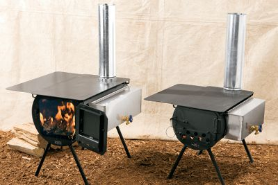 Camp and Hike Built to last, these airtight stoves are made of welded 18 steel that holds heat longer and gives off more radiant heat than sheet-metal designs. Welded braces underneath the stove surfaces keep them flat and warp-free. Rounded main cylinders allow for uniform expansion and contraction while helping ashes settle to the bottom to prevent burnout. Recessed stove pipe holes are offset for a larger cooking surface. Damper baffle plates on the inside of the door reduce the escape of puffing smoke and sparks. The legs are 12-diameter threaded pipe that tighten or loosen to level the stove. Attachments on both sides accommodate warming trays and water heaters. Both models are finished with heat-resistant black stove paint. Spruce holds heat for 4-6 hours. Timberline holds heat for 6-7 hours. All components stow in the stoves for transport. Packages include a set of 12 legs, brass faucet, warming tray, water heater, stovepipe, stovepipe damper, spark arrestor, wire handle for the stove and a coal grate. Made in USA. Available: Spruce Stove Package Timberline Stove Package Color: Gray. Type: Tent Stoves. - $479.99