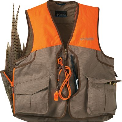 Hunting Proven on countless upland hunts, Columbias Performance Hunting Gear guarantees long-lasting durability along with pro-grade features. Hunt all day in warm weather and enjoy cool comfort no matter how much ground you cover. Back mesh insets enhance airflow to prevent overheating. Sturdy polyester canvas construction wards off thorns and brush. Two cargo pockets at the sides feature handy shell storage with elastic shell holders on the flaps. The rear game bag has snaps to increase or decrease bag volume, is outfitted with game-cooling mesh panels, and a top zipper that allows the bag to be laid open for easy cleaning. Lightly padded shooting panels at the shoulder reduce felt recoil. Relaxed fit for free movement and easy wearing over layers. Imported.Sizes: S-2XLColor: Flax/Blaze. - $120.00