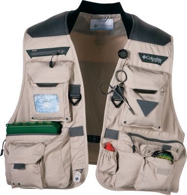 Fishing When youre out midstream and need to switch flies, or launch a nymph past 30 feet, the last thing you need is for your vest to get in the way and make things difficult. The updated Henrys Fork V Vest by Columbia makes an anglers life easier with a lighter, more balanced construction and easy-to-access pocket design. Additional improvements include a quick-drying, Omni-Shield polyester shell renowned for its honeycomb structure that not only provides added strength, but incredible stain and water resistance. An amazing 12 pockets have been organized and strategically placed for maximum convenience. This includes an array of zippered pockets, a license holder, retractable rod-butt holder and even a couple of pockets to hold your favorite beverage. Once weighed down with gear, the Columbia Comfort System kicks in with increased padding and a yoked back that evenly distributes the weight for all-day comfort. Machine washable. Imported.Sizes: S-2XL.Color: Fossil. - $59.88