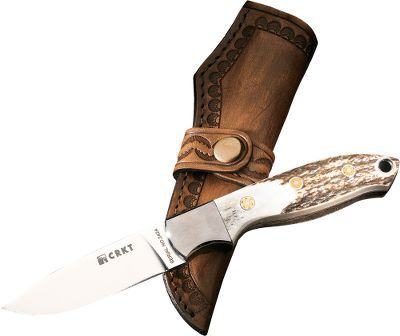 "Camp and Hike A no-nonsense hunting knife with a tried-and-true design for serious outdoorsmen who appreciate old-fashioned quality. Its classic stag handle provides a firm grip for the all-purpose drop-point blade. Mirror-finished, high-carbon 9Cr18 stainless steel gives a long-lasting edge and increased tensile strength, and its hardened for wear- and abrasion-resistance in demanding field conditions. The pinned stainless steel bolster acts like a crossbar-less hilt on the 3"" blade for streamlined performance that won't snag on belts or webbing. The hand-finished stag handles are fastened with mosaic pins for a detailed look that bespeaks its value as a tool and heirloom. Created by knifemaker Russ Kommer, a longtime hunting and fishing guide. Tooled leather sheath included.Weight: 4 oz.Length: 7-1/4"". - $79.88"