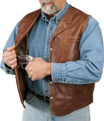 This full-grain leather vest has two concealed holster pockets to fit most handguns. Removable retention straps secure your firearms. Pockets abound, including pig-suede-lined front pockets; an upper external chest pocket; two internal breast pockets and a lower internal zippered pocket. Buffalo-nickel snaps. Color of leather may vary. Imported. Even sizes: 42-56. Colors: Tan, Brown. Size: 52 CL LAPEL CC VEST. Color: Tan. Material: Leather. Type: Concealed Carry. - $199.99