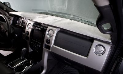 Protect your dash from the sun's damaging effects and cut down on glare with a custom-fit dashboard cover. CAD designed from the original vehicle dash to complement all cutouts, sensors, cupholders and air bag openings. Constructed of the highest-quality, low-pile polyester carpet. Made in USA. Colors: Tan, Gray, Charcoal, Black, Dark Blue, Blue, Beige, Caramel, Taupe, Red, Wine. Color: Gray. Type: Custom Dashboard Covers. - $34.99