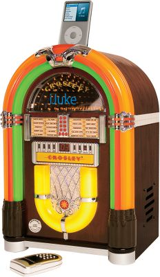 "Entertainment The happy marriage of classic jukebox looks and modern-day music convenience. A full-range stereo and fun LED light effects get it rockin and rollin . Stylish wood finish. Full-function remote control. Dimensions: 18""H x 12""W x 9-1/2""D. Packaged weight: 14 lbs.Available: iJuke Jukebox with iPod Dock Just plug an iPod into the front-docking balcony and play. iJuke Jukebox with iPod and CD Player Dock and listen to your iPod or play your favorite CDs. - $299.99"