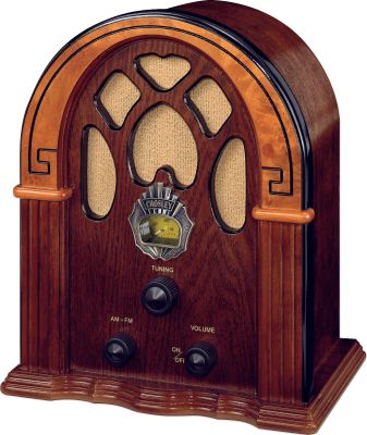 In the 1930s the cathedral-style companion radio was a status symbol that took center stage in living rooms across the country. This radio is crafted with the attention to detail that will make you nostalgic for those simple, bygone days, but the full-range speaker quality will tell you the best of todays technology is in play. Makes a majestic addition to any home or office. External FM antenna and analog tuner. Weight: 3 lbs. Dimensions: 10.75H x 9W x 5.75D. Color: Walnut. Color: Walnut. Type: Radios. - $59.99