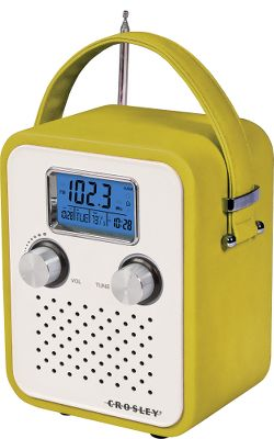 This chic AM/FM alarm-clock radio has a handle and is willing to travel. Pop in batteries (4 AA) and carry your music with you or use the AC power adapter and plug in at home or work. The large, easy-to-read digital screen displays time, date, station and alarm information.The vibrantly colored vinyl-wrapped wood cabinet adds a nice touch to any room. Use the digital tuner to find your favorite station or when you plug in a portable audio device or MP3 player. Either way, the dynamic full-range speaker will impress you with the quality for the size and price.Dimensions: 6.4H x 5W x 3.7D.Weight: 2 lbs.Colors: Green, Blue, Pink. - $49.99