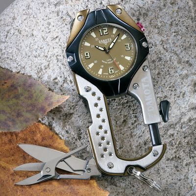 Camp and Hike This all-in-one multitool clip watch with a stainless steel spring-clip knife, side-mounted compass and scissors packs everyday-survival essentials that rugged outdoorsmen require. The carabiner clip keeps it safely at your side. It features a classic military dial. A stainless steel bezel, polished-steel front plate, and stainless steel and aluminum case construction give it solid strength. Submersible to 100 ft. Miyota movement. 24-hour analog. Integrated spring clip. Attached split ring. Phosphorus-colored hands and markers. Ultrabright LED microlight. Case diameter: 2 . Color: Aluminum. Gender: Male. Age Group: Adult. Pattern: Solid. Type: Clip Watches. - $69.99