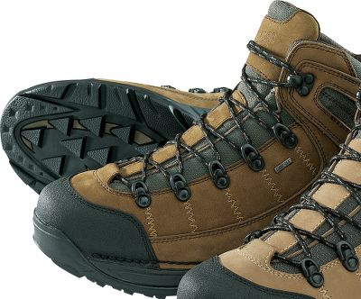 Camp and Hike When it comes to footwear, the Danner name is legendary for lasting quality and performance. The 453 GORE-TEX carries that reputation forward with a hiking boot that is lightweight, yet rugged and 100% waterproof. GORE-TEX liners ensure dry feet while the Terra Force X midsole/shank system blends comfort and support with optimal protection. Uppers are a combination of nubuck leather and durable fabric, green canvas in one model and gray nylon in the other. The 453 also features Danners Approach TFX outsole, an innovative and aggressive design made to facilitate exceptional traction on the varied surfaces one encounters on a trail. Ht: 5.5. Avg. wt: 3.2 lbs./pair Mens sizes: 8-13 D and EE widths. Half sizes to 12. Colors: Tan/Green, Tan/Gray. Size: 8.5. Color: Brown. Gender: Male. Age Group: Adult. Material: Leather. Type: Boots. - $143.99
