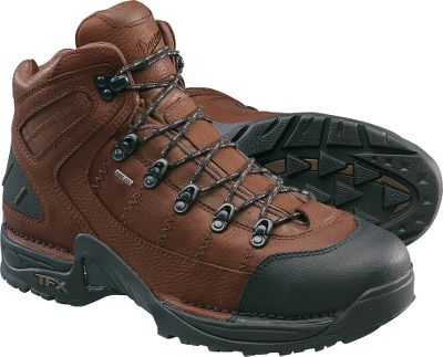 Danners 453 GORE-TEX Steel-Toe Boot broke the work-boot mold with its sleek and sporty design. It looks every bit as much of an outdoors boot as it does a 9-to-5 work boot. Featuring full-grain leather and a scuffproof toe cap that provides extra protection. A GORE-TEX liner keeps feet dry while the Terra Force X support system makes the boot lightweight and comfortable. Danners aggressive TFX-sculpted tread can handle a trail just as easily as it can a work site. The X-frame design features triangle-shaped lugs for improved acceleration and downhill braking. Exterior lugs will keep you balanced when the work or trail goes up a hill. All lugs are beveled to prevent debris buildup. ASTM-approved steel toe. Mens sizes: 8-14 D, 8-13 EE. Half sizes to 12. Height: 5.5. Average weight: 3.4 lbs./pair. Color: Brown. Size: 9.5. Color: Brown. Gender: Male. Age Group: Adult. Material: Leather. Type: Work Boots. - $149.99