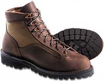 "Camp and Hike Cover miles on the trail in an boot that's waterproof, rugged and comfortable. Danner's women's GORE-TEX Light II hikers are an ideal all-around outdoor boot for camping, fishing or long walks, and they're perfect for wear to work or around town, too. This time-tested Danner classic boasts Danner's stitchdown construction. The full-grain nubuck waterproof leather resists moisture, and the 1,000-denier Cordura nylon uppers resist the scuffs, abrasions and tears caused by tough terrain. A Gore-Tex bootie keeps water out, and the moisture-wicking lining ensures your feet stay dry over the miles on the trail. The Vibram 148 Kletterlift outsole provides support and traction on tough terrain. An airthotic footbed and dual-density rubber and polyurethane midsole ensure your feet stay comfortable. Each also has a padded collar for added comfort. Made in USA.Height: 6"".Average Weight: 3.8 pounds.Color: Brown.Women's Sizes: 5-11 Medium. Half sizes to 10. - $319.99"