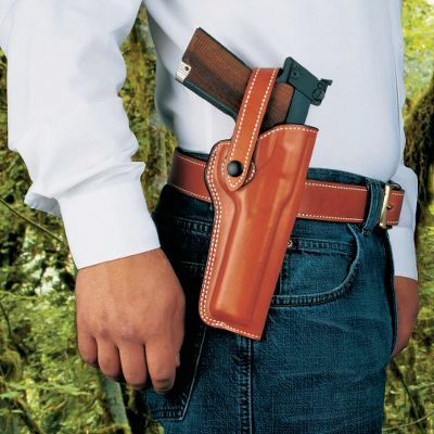 "The Woodsman is a lined, molded, premium saddle leather holster with an adjustable safety strap. It will fit most .22 autoloaders with barrel lengths from 4-1/2"" to 5-1/2"". Fits belts up to 2-1/4"" wide. - $39.88"