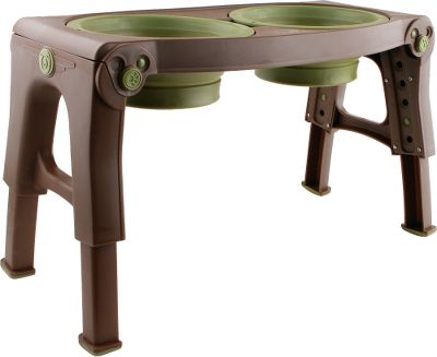 Camp and Hike This elevated pet feeder grows along with your pets! Adjustable legs raise the feeding bowls on the stand from 8 to 13 high. This elevated position alleviates stress placed on pets joints as they lean forward to eat. It also improves digestion and encourages a more ergonomic feeding posture. This is a perfect feeding-bowl option for older dogs, dogs with arthritis and especially tall breeds. The bowls are detachable and dishwasher-safe. Each bowl has a 4-cup/32-oz. capacity. The entire unit, including the bowls, collapses down for easy transport or storage. Works great wherever you are -- home, RVs, boats, cars, hotels and camping.Dimensions:19.25L x 9.375W x 2.75H.Color: Brown/Green. Type: Pet Feeders. - $40.49