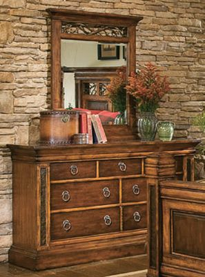 Hunting Bring the natural majesty of the Big Sky country to your bedroom dcor with the premium Montana Collection. Features richly grained birch and select maple with a rustic Deer Lodge finish for the perfect mix of elegance and careworn appeal. This chest is truly a handcrafted work of art offering top-grade functionality and heirloom-quality durability. Hammered metal inserts add eye-catching texture and perfectly complement the natural warmth of the wood frame. The nine drawers (six large, three small) are all fully sealed, felt-lined and made of solid wood. Crafted with first-rate English or French dovetail joinery, waxed wood-on-wood drawer slides and exclusive hardware throughout. Imported. Dimensions: 45H x 56W x 20D. - $1,549.99
