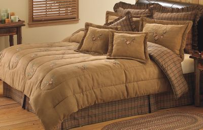 Entertainment You can almost hear the faint whistling of the wind through nearby pines in a bedroom accented with our Pine Cone Bedding. Breathe deeply, pull the luxurious suede Comforter to your face, close your eyes and youre there amid the pines. The Comforter and Standard Sham have richly embroidered, dimensional pine cones on faux suede. The front is made of 100% polyester with a 100% cotton back and 100% polyester batting fill. Plaid Pillow and Bed Skirt are made of 100% cotton. Comforter Set includes comforter, plaid pillow, two standard shams and a bed skirt. Machine washable. Imported. Available: Full (76 x 88) Queen (90 x 92) King (101 x 92) California King (120 x 108) Color: Brown. Size: FULL. Color: Brown. Type: Bedding Sets. - $219.99