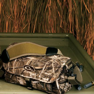 "Hunting Here's a rugged bag made to keep your shells not only readily accessible, but also protected from the harsh weather die-hard waterfowlers often encounter. In addition to the same tough, PVC-backed polyester shell found on the other bags in this series, the Shell Boss is outfitted with a removable plastic floor insert for added support and stability when carrying multiple boxes of shells. It also has two adjustable inner dividers to help you keep different loads apart in the bag. Exterior pockets have shell loops and choke tube holders. Open one up and the first thing you see is a removable clear vinyl see-through zippered map pocket providing instant access to your WMA maps, topo maps, sunrise/sunset charts and other important information. The interiors are a light-reflecting tan color so you can locate contents easier. Multiple storage pockets line the walls of the bags to eliminate the frustration of sorting through a jumbled mess to find what you need. A grab opening under the top flap allows quick access to shells while keeping the other compartments covered. A thread-trough carry handle and Neostretch shoulder strap make it easy to tote to the blind. See-through map pocket. Outer face pocket outfitted with elastic shell/choke tube dividers.Dimensions: 13-1/2""W x 7""H x 7-1/2""D.Camo Patterns: Advantage MAX-4 HD , Mossy Oak Duck Blind . - $24.99"