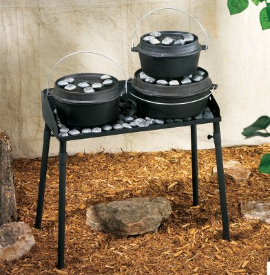 Entertainment Top holds up to three ovens and charcoal. Fold-down three-sided windscreen. Steel construction. Leg extensions detach for easy packing. Dimensions: 32L x 14W x 32-1/4H. Color: Black. Type: Dutch Oven Tables. - $99.99