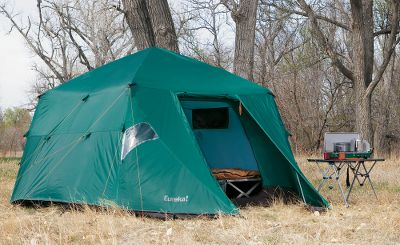 "Camp and Hike As the designers of the legendary Bombshelter tent, Eureka knows what goes into crafting one of the most popular and durable tents of the last 25 years. Thats why Cabelas has partnered with Eureka to offer you a tent that actually betters the guide-proven original. Named after the worlds most technologically advanced tank, this tent is engineered to more than live up to its namesake. When properly anchored with 13 anchor points on each side, this rock-solid, weather-blocking structure capably withstands natures worst fury. Construction highlights include a 68-denier polyester ripstop fly with 5,000mm waterproof-rated coating, 210-denier oxford nylon floor with a 5,000mm coating and 75-denier polyester taffeta body. The super-strong 1-dia. aluminum poles deliver maximum structural support. Fly attaches to sides of tent body with five locations on each side for added strength in the wind, increased interior space and enhanced ventilation. Adjust the stake-out attachment loops with buckles to maintain the flys tautness when wet. Wire-grated carabiner-style clips ensure quick, secure attachment of tent body to frame. The 210-denier snow flaps on the vestibules enhance weight-bearing support. Use the two zippered triangular roof vents to adjust ventilation. The 6-long dual zipper pulls allow easy grip with gloves. Two large D-style doors have half-mesh windows backed by woven fabric. Clear window in fly vestibule. Attached high-visibility guy-out points. Two hanging gear bins. Includes carry bag. Manufacturers lifetime warranty. Cabelas exclusive. Imported. Weight: 41 lbs. 8 oz.. Type: Outfitter Tents. Sleeping Capacity: 5 Person. Model: M-1 Outfitter Tent. Floor Size: 9.5' x 9.5'. Center Height: 6'11"". - $699.88"