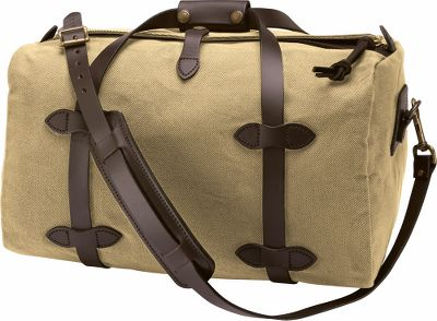 Camp and Hike The style and attitude of a Rolls Royce in the body of a tank. Thats the standard Filson built its name upon, and its the promise you can count on in every one of their duffels. 100% 22-oz. twill cotton has an oil finish for weather resistance. Bridle leather carry handles and handgrip. Removable, adjustable bridle leather shoulder strap with cushioned shoulder pad. Storm flap with snap tab. Made in USA.Sizes:Small - 10-3/8H x 18W x 11DMedium - 14H x 25W x 13DLarge - 14H x 30W x 13D.Colors: Tan, Otter Green. Type: Duffel Bags. Size Small. Color Tan. - $260.00