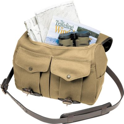 Camp and Hike Constructed of water-repellent 22-oz. 100% cotton, oil-finished rugged twill with 100% genuine bridle leather, this bag is ideal for long days in the field. It has a large flap completely covering the oval-shaped opening so nothing bounces out. It features one full-width open rear pocket, two open side utility pockets and two expandable front pockets with snap flap closures. Bridle leather padded shoulder strap and double-layer bottom stand up to extra-heavy loads. Meets carry-on requirements. Manufacturers lifetime warranty. Made in USA.Dimensions: 11H x 14W x 5D. Weight: 3.5 lbs.Colors: Tan, Otter Green. Type: Field Bag. Size Medium. Color Tan. - $248.00