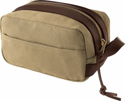 Camp and Hike Any travel kit can get your personal items from point a to point b, but a travel kit from Filson will do it for the rest of your life, and look as good as the day you got it. 100% cotton, oil-finished, rugged twill shell is accented with bridle leather trim. Two open pockets inside and out and an interior thats fully lined with nylon. Leatherloop handle and brass zipper with a leather pull. Made in USA.Dimensions: 10L x 6W x 6H.Colors: Tan, Otter Green. Type: Toiletry Kit. Size Small. Color Otter Green. - $95.00
