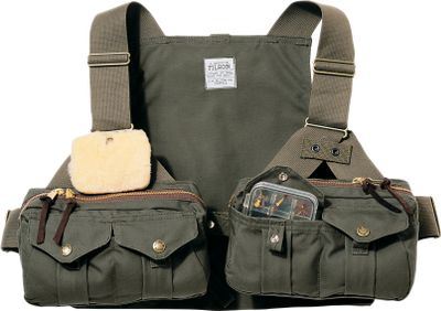 Flyfishing Filson's Shelter Cloth strap vest has two large zippered pockets with four interior pockets and an open-section for large fly boxes. On the exterior back side of the zippered pouches are two tippet/leader pockets and a security pocket, all with snaps. Made in USA.Sizes: S/M/L, XL/2XL/3XL. Color: Otter. Type: Vests. Size S/M/L. Color Otter. - $185.00