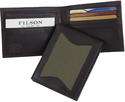 Entertainment Filsons legendary reputation for timeless style and uncompromising quality appeals to any outdoorsman who wants to own the very best. Outfitter Wallet has eight card slots, a rear security pocket on each interior side and two full-width currency slots. Made in USA. Dimensions: 4-1/2L x 3-1/2W.Colors: Otter Green, Tan. - $95.00