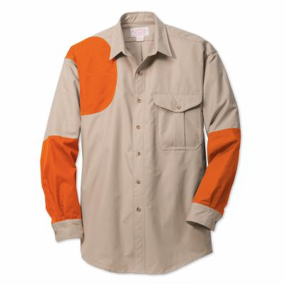 Hunting True to Filsons legendary reputation for uncompromising quality, this shirt appeals to outdoorsmen who demand the very best from their clothing. It has double-layer protection around the forearm and a protective shooting patch. Constructed of lightweight, abrasion-resistant cover cloth, the shirt has an updated fit for enhanced mobility. Interior pocket accommodates recoil pads. Chest pocket with button flap closure. Adjustable button cuffs. Machine washable. Made in USA and Imported.Sizes: S-2XL.Colors: Tan/Otter Green, Tan/Blaze. Type: Long-Sleeve Shirts. Size: X-Large. Camo Pattern: TAN/OTTER GREEN. Size Xl. Color Tan/Otter Green. - $172.00