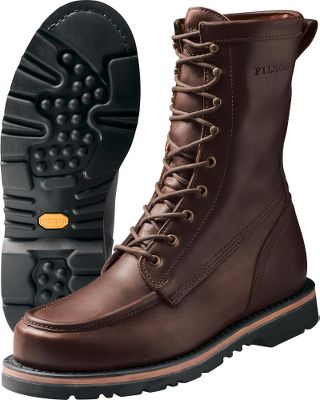 Hunting True to Filsons legendary reputation for uncompromising quality, these boots appeal to outdoorsmen who demand the very best from their clothing. The full-grain, oil-tanned cowhide uppers repel water. Leather/rubber midsoles, fiberglass shank arches and cork/polyurethane insoles add support. Durable welt construction with moccasin toes. Vibram Aztech rubber outsoles grip wet and dry terrain. Brass fittings. Pull strap. Waxed laces. Imported.Mens sizes: 8-13 D width; 9-12 EE width. Half sizes to 12. Color: Brown. - $314.99