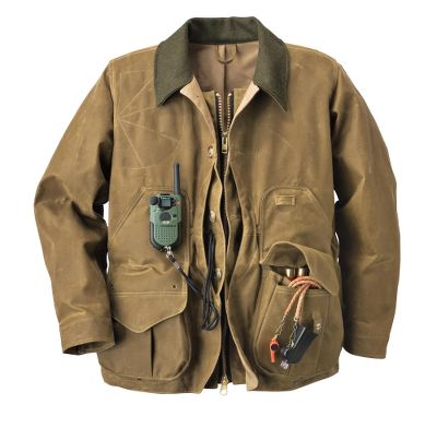 Hunting A traditional hunting classic thats built to last. Made of 12.5-oz. cotton Tin Cloth with a water-repellent oil finish, this Field Coat protects the wearer from the elements and resists briars and burs. A front- and side-loading game bag is easily accessible during intense hunts. The 8-oz. cotton Shelter Cloth lining provides extra protection to the front and upper back. Handwarmer pockets for extra comfort on frosty days. Lower bellows pockets with button-tab closures and six shell loops each. A pleated action back delivers a full range of movement. This coat features a brass zipper and button-front closure with a storm flap, Tin Cloth loops for handheld dog transmitters, lanyard security loops inside the front game bag and a padded shooting patch on the right shoulder. The adjustable snap cuffs and wool-lined collar complete the package. Wipe or brush clean only. Made in USA. Sizes: S-2XL. Color: Tan. Size: S. Color: Tan. Gender: Male. Age Group: Adult. Material: Cotton. - $395.00