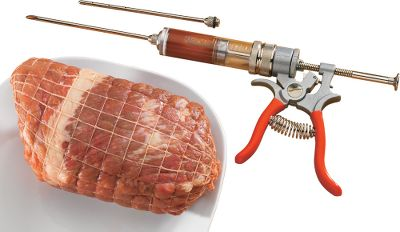 Get extra flavoring beyond surface marinades and rubs using this commercial-grade gun. Injects flavoring up to a 5-1/2 -depth. Patented adjustable dial lets you adjust the flow of the marinade or seasoning mix from 1ml to 5ml per injection shot. Includes a slanted, open-tip needle for injecting marinades with small spice or herb particles and a closed-end needle with side perforations for liquid-only injections. Nickel-plated brass and die-cast zinc. FDA food-borne approved O-rings. 2-oz. capacity. Made in USA. Weight: 1.7 lbs. Type: Tools & Utensils. - $99.99