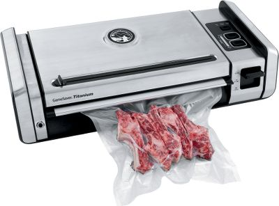 With sturdy, stainless steel construction, built-in handles and high-performance dual pumps, the FoodSaver Gamesaver is a durable vacuum sealer. Designed for heavy-duty, repetitive use, it has two seal settings (single and double), an extra-large seal strip that seals 8, 11 and 15 bags and a built-in roll storage and cutter that simplify the process of making custom-sized bags. The patented drip tray catches overflow and is removable and easy to clean as well as dishwasher safe. Easy-lock latch and extra-large, rubberized buttons. Accessory port. Comes with one 11 x 10 heat-seal roll, one 15 x 10 heat-seal roll, and three 1-gallon dam bags. Compatible with any FoodSaver pre-cut bag. All sealed items can be microwaved, boiled and frozen. Imported. Color: Titanium. Type: Vacuum Sealers. - $449.99