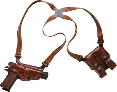 Though produced for many years prior to the television show Miami Vice, it was actor Don Johnsons use of this shoulder holster setup for his Bren 10 in the series that gave what would become the Miami Classic worldwide attention. Since then, it has become one of the most imitated shoulder holster systems in the world and is a favorite of law enforcement and security officials worldwide. A key component of this patented system is its spider harness, all four points of which are connected by a unique clover-shaped Flexalon swivel back plate and pivot independently. The result is a perfect fit, lasting comfort and freedom of movement for handgun carriers of all sizes and shapes. Constructed of premium saddle leather, this system includes a holster, harness, magazine carrier and set of system screw - $174.99