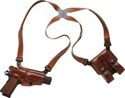 The legacy of this classic shoulder holster can be traced to the 1970s when Galcos predecessor developed a carry rig based on input from the Chicago Police Department. The resulting rig popularized horizontal side carry in a silhouetted holster with a cut-off end. Further refinements came when Galcos Rick Gallagher developed a carry rig actor Don Johnson used to carry his Bren Ten 10mm semiautomatic pistol in the hit TV series Miami Vice, and the Miami Classic was born. A key component of this highly popular shoulder rig is its spider harness. All four points on the harness pivot independently and are connected by a clover-shaped Flexalon swivel backplate. This dramatically increases comfort when carrying large-frame semiautomatic pistols and accommodates a wide range of body types. The holster and magazine carrier are crafted of premium steerhide leather. The rig accepts tie-down, cuff case and flashlight accessory attachments (sold separately). Made in USA. Color: Black. Type: Concealed Carry. - $174.99