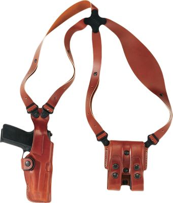 Comfort and durability starts with standard-width full-grain leather harness straps attached at the center with a clover-shaped Flexalon backplate for ease of motion. The harness straps attach to the holster and magazine carrier with a pivoting screw system. The holster and magazine carrier are made of steer hide with secure flaps, protecting your components and providing the comfort of molding to your shape. Can be worn concealed or over clothing. Can be worn right- or left-handed. Made in USA. Available: Beretta 92, 5 1911. Color: Tan. Color: Tan. Type: Concealed Carry. - $184.99