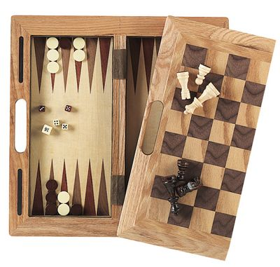 Gather your family and friends for a night of classic board games. Crafted of real wood, this three-in-one game set includes playing surfaces and all the playing pieces needed for hours of chess, checkers and backgammon. Design folds in half for convenient storage and its convenient carry handles lets you take it anywhere. Includes instructions, playing pieces, two cups and dice. Dimensions: 16L x 16W x 1H. - $49.99