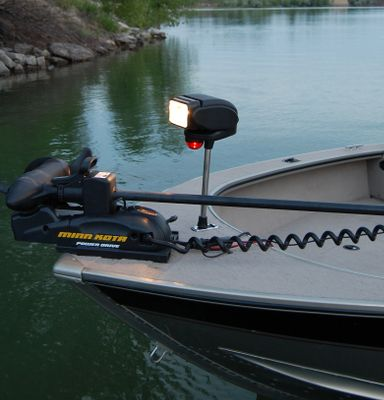 Fishing Navigate safely at night without any extra hands on deck with the wireless, shine-it-anywhere convenience of this bow-mounted spotlight that lets you keep one hand on the wheel. Its 1,000-lumen spotlight rotates 360 and tilts 90 for spotting channel markers and buoys or slowly maneuvering through partly submerged timber and debris. It attaches quickly and easily to any two- or three-pin bow socket. The light assembly is mounted on a 12 stanchion to sit well above your stowed trolling motor. Additional bi-colored navigational light for safety. Dual-speed, programmable remote control lets you operate it from anywhere on your boat. Heavy-duty nylon case included for easy carrying and worry-free storage. Color: Black. Color: Black. - $189.99