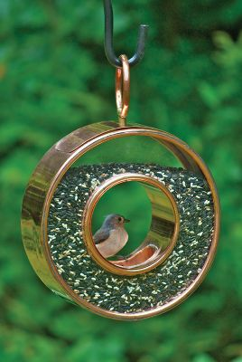 Camp and Hike Enjoy watching birds as they feed in this classic fly-through-style bird feeder. Its crafted of copper and Venetian bronze to give it a unique look. A perfect gift for bird watchers. Dimensions: 15H x 11W.Weight: 6 oz. Type: Bird Feeders. - $79.99