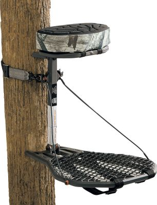 "Hunting Go for mobility with the compact Scout HX. This lightweight hang-on boasts sturdy aluminum HX construction and a seat leveling system. XPE dual-density foam seat with Mossy Oak Treestand camo highlights adds extra support and cushioning. Seat flips up for full platform use. Easy-Cinch dual claw straps ensure quick, secure attachment. Fully adjustable backpack straps allow easy carrying. Stands are tested to TMA standards and include a full-body safety harness with Suspension Relief System (SRS). Imported. Seat height: 20"". Platform size: 18"" x 24"". Weight: 10.5 lbs. Weight capacity: 275 lbs. Camo pattern: Mossy Oak Treestand . A Video Public Service Announcement from theTREESTAND MANUFACTURERS ASSOCIATION - $99.88"