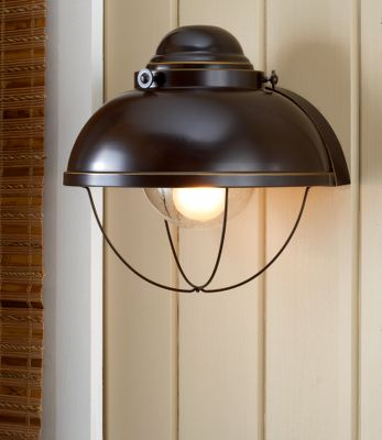 Bring the feel of a maritime port into any room of your home or cabin with the Old World, nautical charm of the flush mount style Fisherman Wall Sconce. Mounting hardware included. Uses a 60-watt bulb (not included). Hard-wire-licensed electrician recommended for installation. Imported. 11H x 111/2W x 10D. Finish: Antique Bronze, Weathered Copper. Color: Bronze. Type: Wall Lights. - $53.88