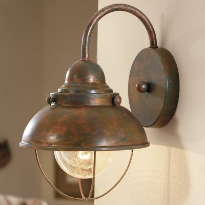 This rustic-looking wall scone will bring a fishermans wharf feeling to any room. Mounting hardware included. Hard-wire-licensed electrician recommended for installation. Uses a 60-watt bulb (not included). Imported. Dimensions: 8W x 12-1/2H. Finish: Weathered Copper, Antique Bronze. Color: Bronze. Type: Wall Lights. - $59.99