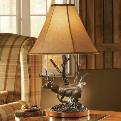 "Hunting Capturing the confident stride of an opposing whitetail buck, master sculptor John Parsons amazing attention to realism is exemplified through perfect posturing and minute details. Every element of animal movement is captured as the artist skillfully projects nature's drama and beauty in sculpture. The lamp base is beautifully veneered for a rich look. The lined faux-suede lamp shade emits a warm, inviting light that's suitable for any room and is reinforced with a steel skeleton. Constructed of cast poly-resin and hand-painted with a bronzed patina, the appearance of this lamp is truly magnificent. It is operated with a three-way twist switch and can accommodate bulbs (not included) up to 100 watts. Imported. Dimensions: 28.75""H (with shade) x 11.6""W x 11""D. - $77.99"