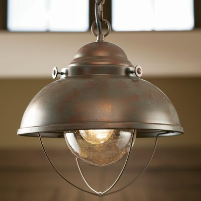 Entertainment Bring the feel of a maritime port into any room of your home or cabin with the nautical appeal of this quaint-looking pendant light. Old World charm gives these lights an authentic antique look. Mounting hardware included. Hard-wire licensed electrician recommended for installation. Includes a 36 metal chain for hanging. 60-watt bulb (not included). Imported. Shade diameter: 11-1/4 Measures: 11W x 12H. Finish: Weathered Copper, Antique Bronze. Color: Bronze. Type: Ceiling Lights. - $99.99