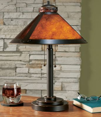 Entertainment This rustic-style lamp features amber mica shade that gives off a soft hue for a pleasant, warm ambience. The top of the shade is accented with a pine cone crown. Two-mode on-off pull chain switch. 6-ft. power cord. 14-3/4-dia. shade. 7-diameter metal base. Imported. Measures: 18H x 16-1/4W x 7-1/2D. - $35.99