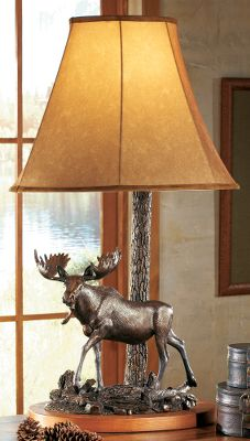 Hunting Master sculptor John Parsons amazing attention to realism is exemplified through perfect posturing and minute details in this moose sculpture. Every movement is captured as the artist skillfully projects natures drama and beauty in this creation. Lamp base is beautifully veneered for a rich look. Lined, faux-suede lampshade emits warm, inviting light. Shade is reinforced by a steel skeleton. Poly-resin cast is hand-painted with a bronzed patina for a truly magnificent appearance. Accommodates bulbs (not included) up to 100 watts. Three-way twist switch. Imported. Dimensions: 34H (with shade) x 21W x 16D. - $109.88